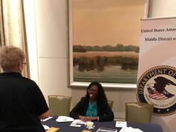Outreach Specialist Khalilah Escalera speaks with attendees.