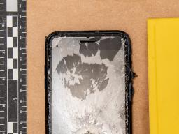 Evidence photo of a shattered iPhone.