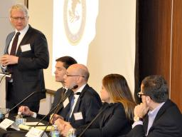 Principal Deputy Chief Josh Goldfoot of DOJ's Computer Crime and Intellectual Property Section moderates a panel discussion.