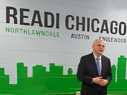 Attorney General Garland speaks with press at a READI Chicago meeting.