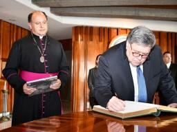 Attorney General Barr signs the guest book at the Basilica of Our Lady of Guadalupe