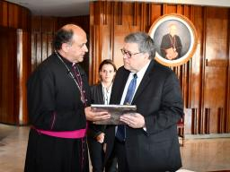 Attorney General Barr receiving a gift from Monsignor Salvador Martinez Avila, the Rector of the Sanctuary of the Basilica.