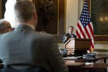 U.S. Attorney Trent Shores speaking at a podium.