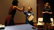 FBI Special Agent in Charge Voviette Morgan presents girl with certificate.