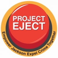 "Red eject button with the words ""Project Eject"" written on the top and Empower Jackson Expel Crime Together under the button"