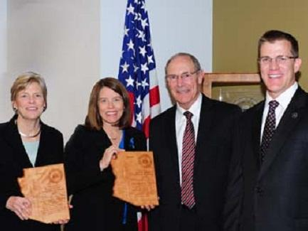 AUSAs Sharon Sexton (First Assistant Betsy Strange standing in for Sharon) and Jennifer Green receiving FBI honor