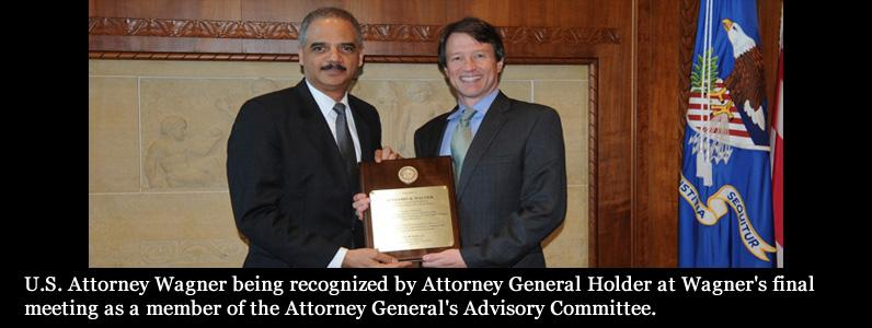 U.S. Attorney Wagner being recognized by Attorney General Holder