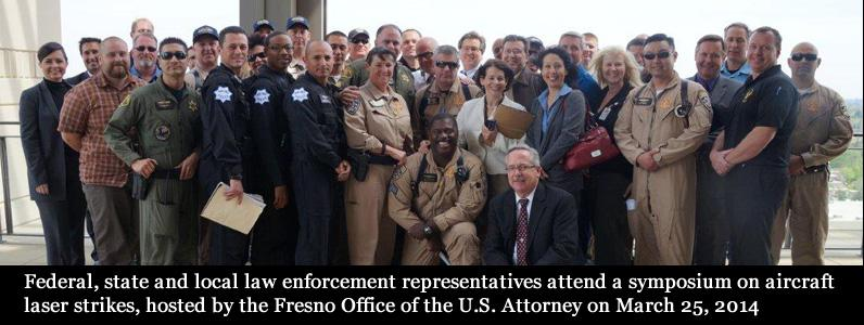 Federal, state and local law enforcement attend a symposium on aircraft laser strikes, hosted by US Attorney in Fresno