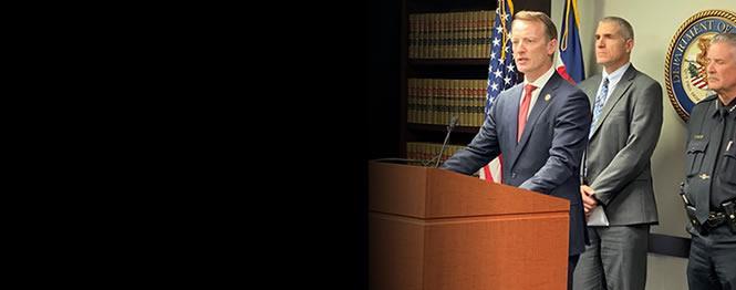 U.S. Attorney Jason Dunn, FBI SAC Dean Phillips & Pueblo Police Chief Troy Davenport addressing members of the media