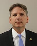 National Center for Disaster Fraud Executive Director Corey Amundson