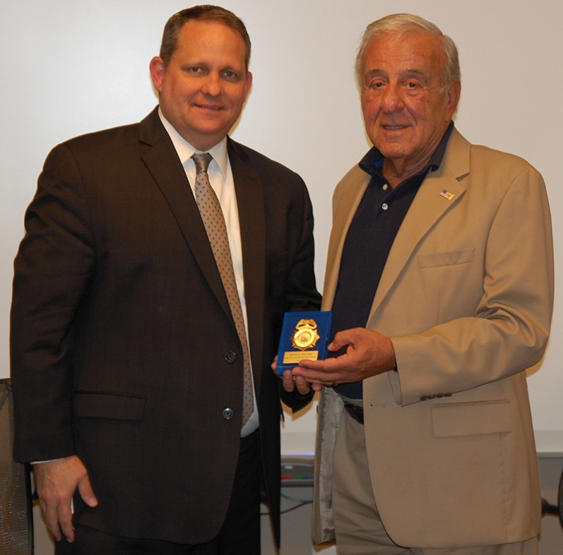 Current USNCB Director Wayne H. Salzgaber presents the first USNCB Chief, Kenneth S. Giannoules, with a token of appreciation.