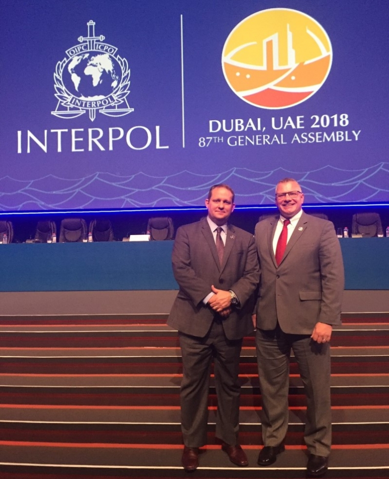 INTERPOL Washington Director Wayne Salzgaber (left) and Deputy Director Michael Hughes attended the 87th INTERPOL General Assembly.
