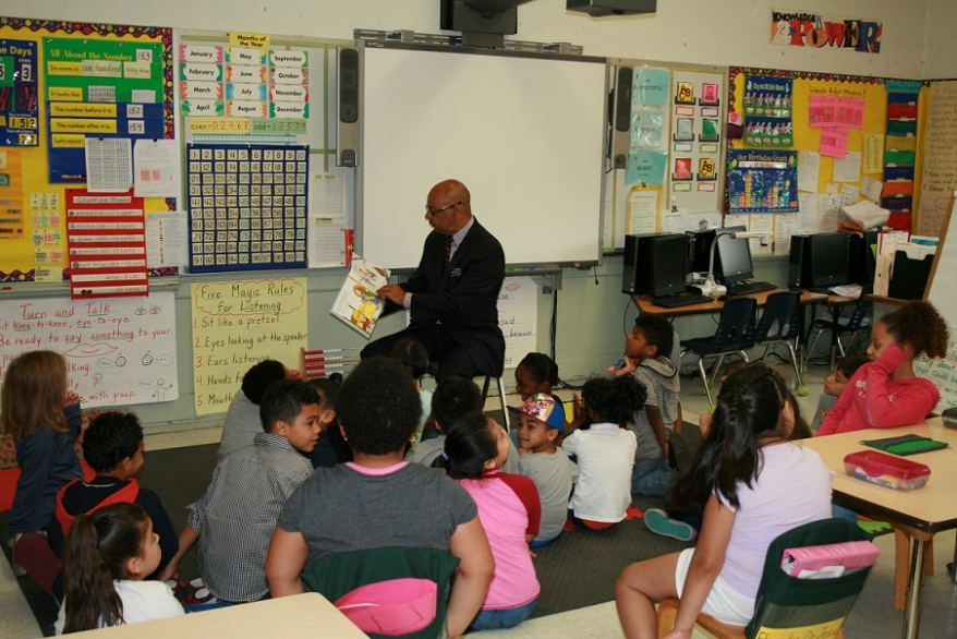 Who had more fun celebrating Reading Week at the Frank Spaziano Elementary School Annex today – Assistant U.S. Attorney Richard Rose or the first grade students?