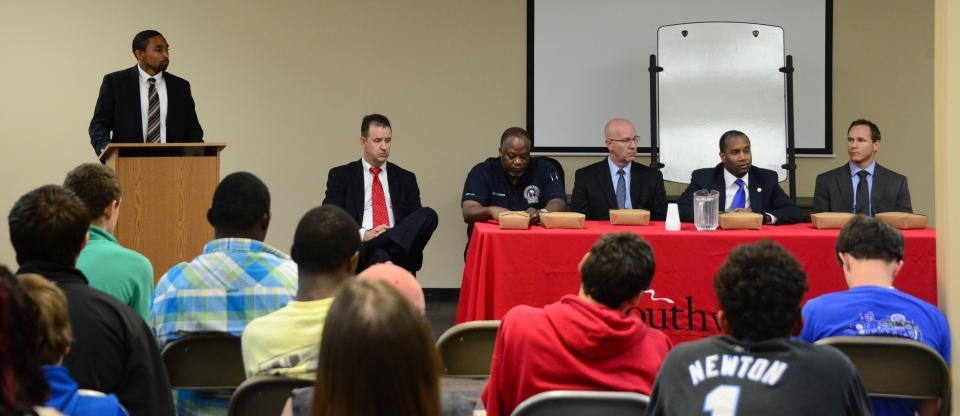Law enforcement officials talk to young men at Youth Villages-Bartlett during panel discussion.