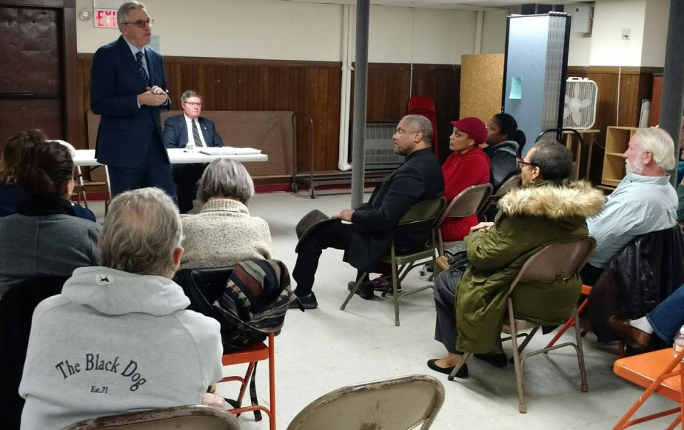 United States Attorney Peter Neronha and First Assistant US Attorney Stephen Dambruch (seated) discuss civil rights protections and community/police relations with the Mt. Hope Neighborhood Association Crime