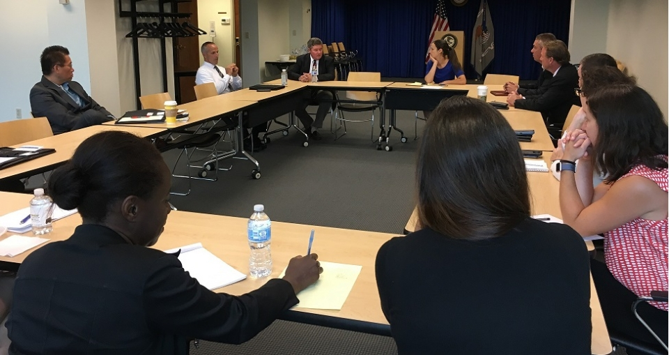 On August 2, 2017, Acting United States Attorney Stephen G. Dambruch (top left) and Assistant U.S. Attorney Amy R. Romero hosted federal prosecutors and federal law enforcement agencies from across New England in a roundtable discussion about identifying, investigating and prosecuting civil rights violations. The working group discussed best practices for working together on civil rights outreach, investigations and enforcement efforts.