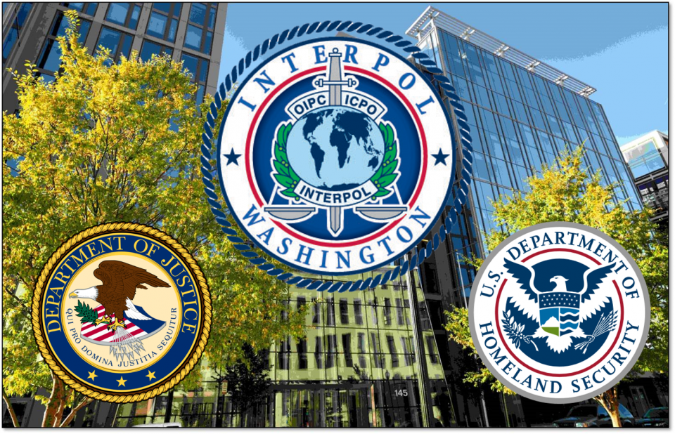Photo of Constellation building 2 with seal of Justice, INTERPOL Washington, and Homeland Security