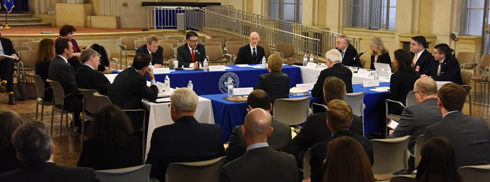 Makan Delrahim (center), Antitrust Division staff, Roundtable Participants, and members of the public participating in the Public Roundtable Discussion Series on Deregulation & Antitrust Law in the Great Hall of the Main Justice Building
