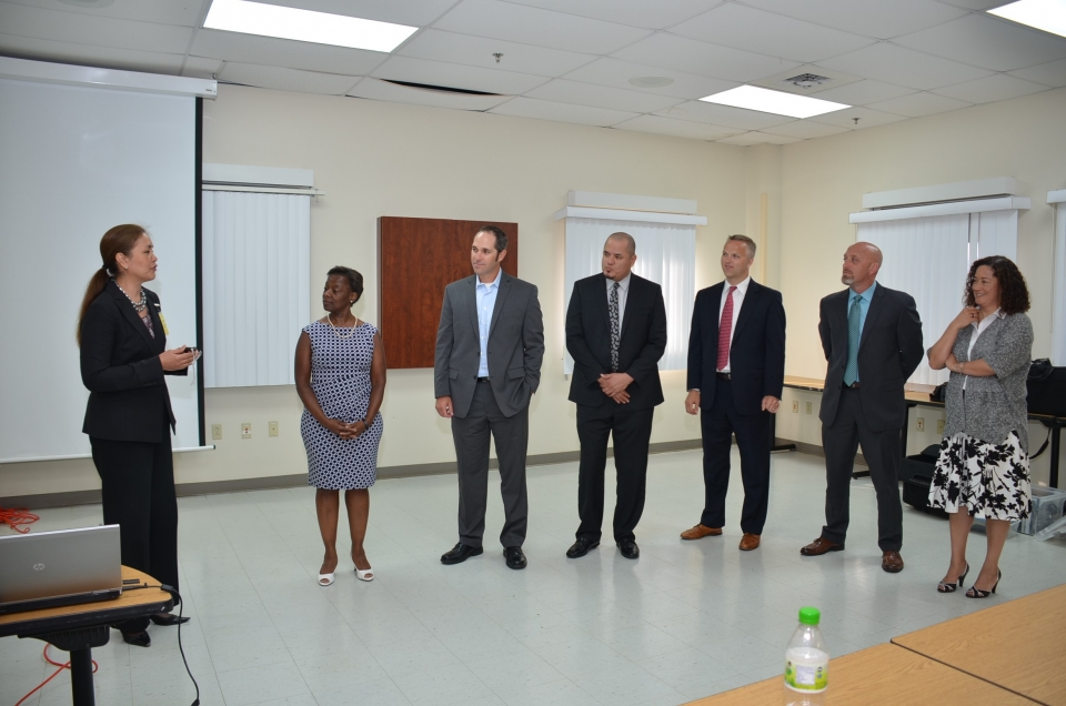 Picture of U.S. Attorney Alicia Limtiaco showing her appreciation to the trainers for their roles in the OCDETF Training held in Guam and Saipan, NMI