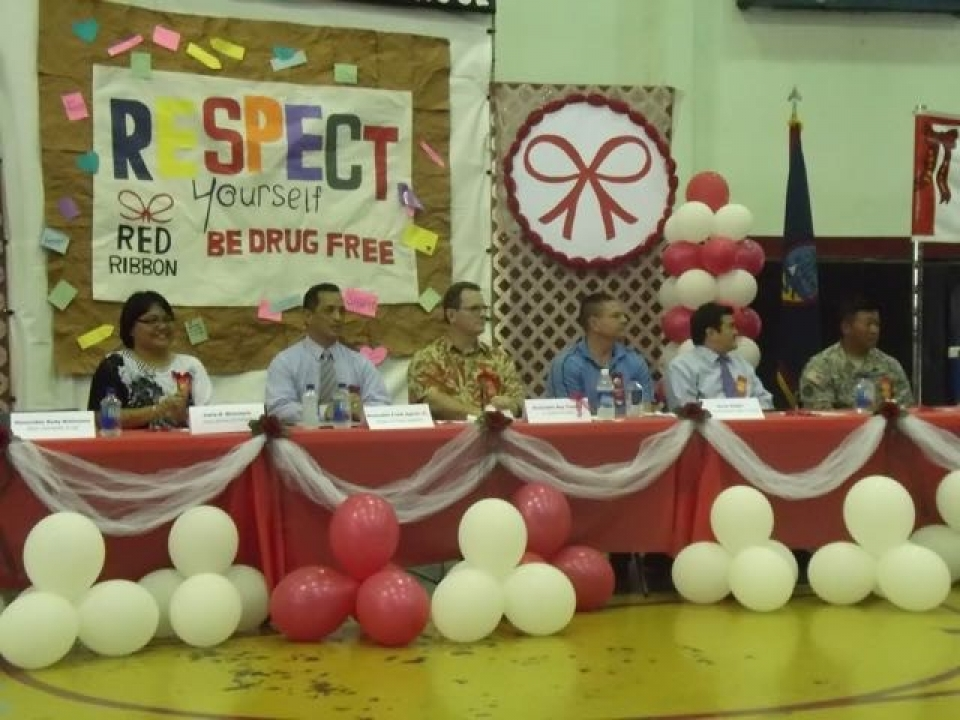 Picture of Dignitaries awaiting the start of the Red Ribbon events at Simon Sanchez High School in Guam