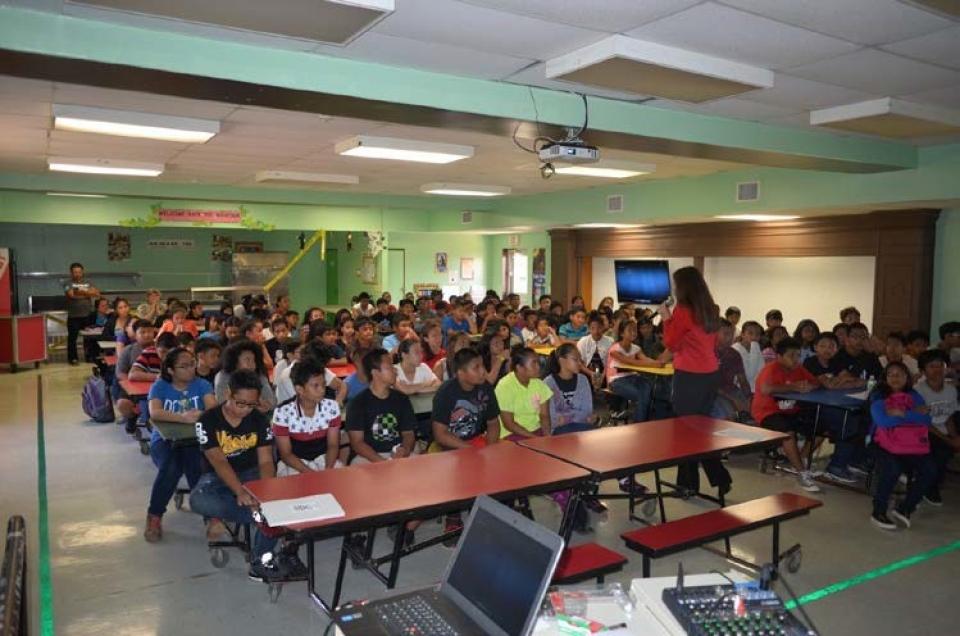 Pcture of U.S. Attorney Alicia Limtiaco at the school outreach at Dandan Elementary School in Saipan, NMI