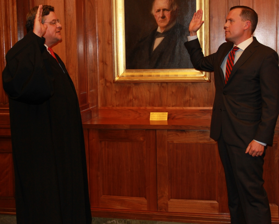 U.S. Attorney Russell Coleman taking oath of office. Administered by U.S. District Judge David J. Hale