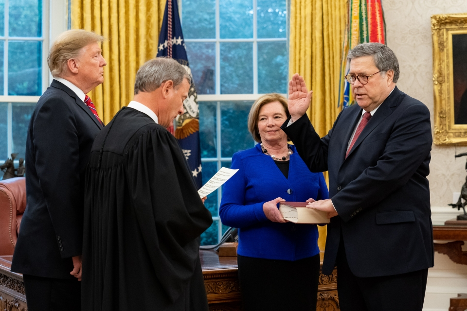 President Donald J. Trump participates in swearing-in of William P. Barr administered by U.S. Supreme Court Chief Justice John Roberts on February 14, 2019.  Attorney General Barr's wife, Christine, holds the Bible.