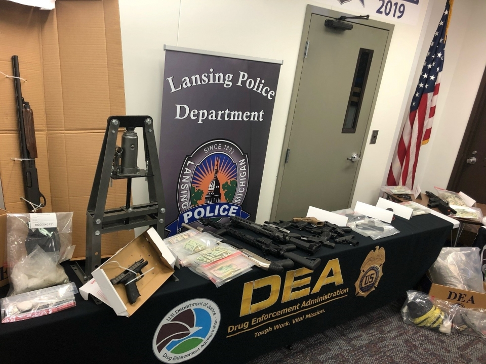 Guns and money seized