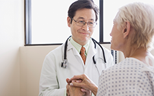 Concerned doctor with elderly patient