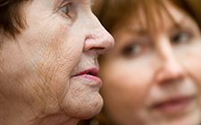 Alarmed older woman with younger woman