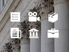 Thick white pillars with ornate decorations at the top. Icons of resources are on top of the image – Access a comprehensive collection of DOJ's hate crimes resources.