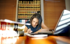photo of woman studying law books