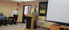 6th District Community Outreach Specialist Floyd Carson, in partnership with 6th District Metropolitan Police Department Officer George Hill, speaks to seniors at a Senior Wellness Event.