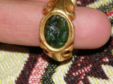 Gold ring with carved gemstone