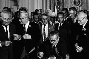 President Lyndon Baines Johnson signs the Civil Rights Act of 1964