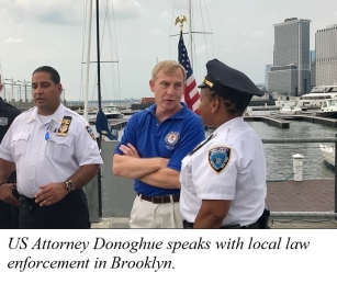 US Attorney Donoghue speaks with local law enforcement in Brooklyn.