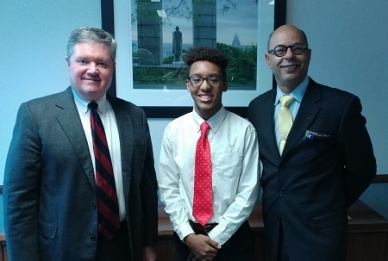"""Acting U.S. Attorney Stephen Dambruch and AUSA Richard Rose welcomed Hendricken High School JuniorJr. Jaylin Wilson. In addition to chatting with prosecutors, Jaylin sat in on a jury trial and looked on as a grand jury returned an indictment as he """"checks out"""" career options."""