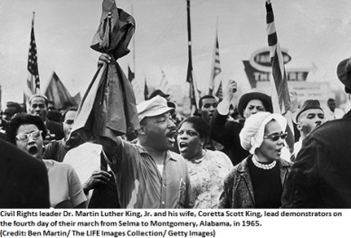 Rev. Dr. Martin Luther King, Jr. and his wife, Coretta Scott King, lead demonstrators on the fourth day of their march from Selma to Montgomery, Alabama