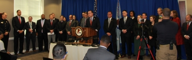 USA Russell Coleman flanked by Assistant United States Attorneys and law enforcement partners