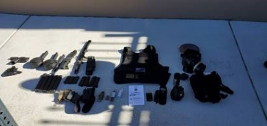 Photograph of items recovered from Hughes' vehicle