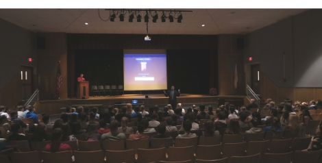Freshman and senior students at Portsmouth High School listen intently to a discussion about opioid and heroin addiction