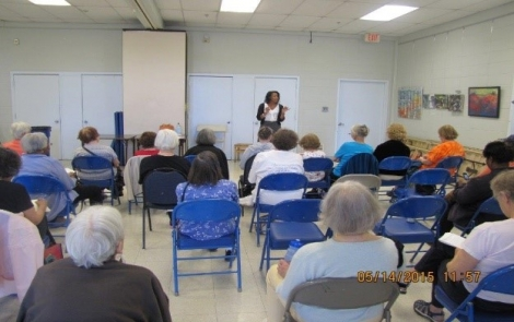 2nd and 4th District Community Prosecutor Trena Carrington at a Senior Seminar at Chevy Chase Community Center.