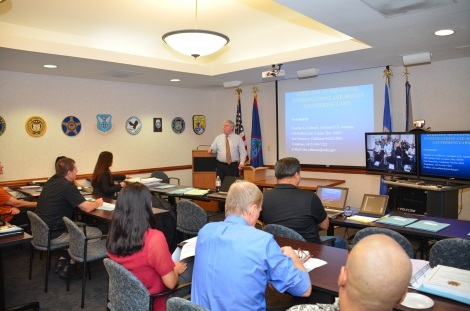 Picture of Assistant U.S. Attorney Thomas Colthurst giving an Overview of Financial Investigations and Money Laundering Laws