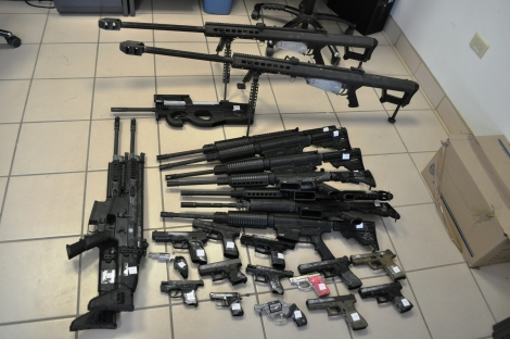 Assorted military style rifles and collection of handguns