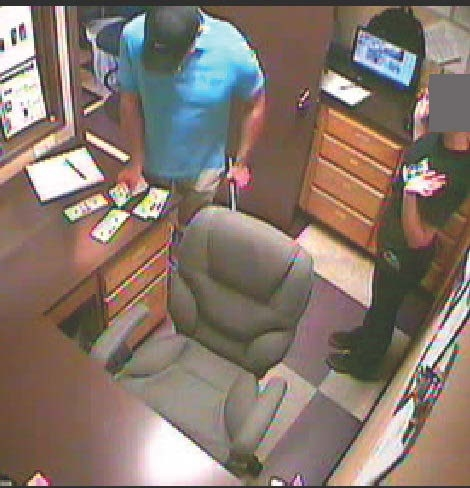 Jones collects money during armed robbery at the Purple Parrot in Medford.