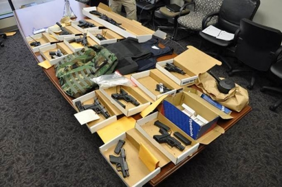 Firearms and vests seized during the execution of a DEA Tactical Diversion Squad search warrant for Operation Press Play, part of the June 2018 National Health Care Fraud and Opioid Take Down