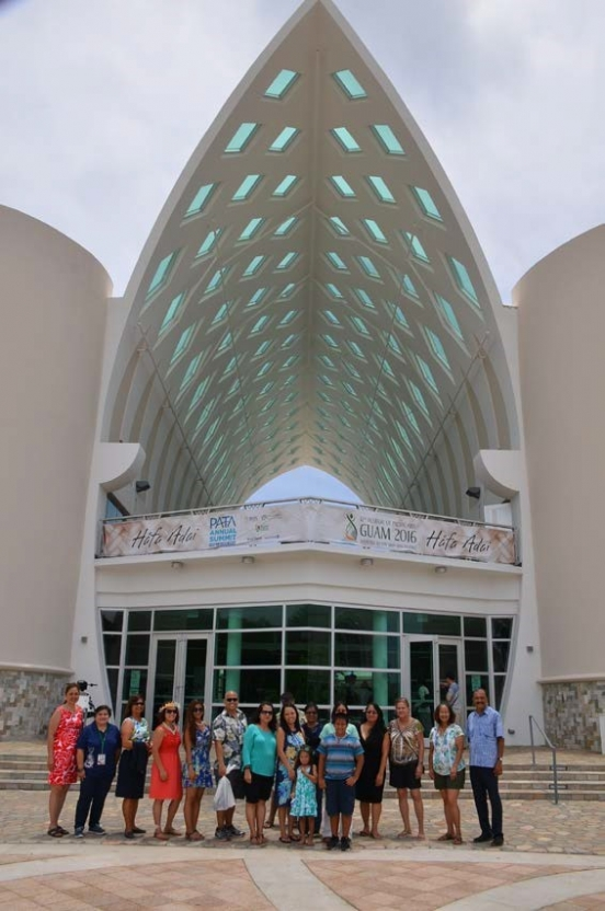 Picture of U.S. Attorney Alicia Limtiaco and USAO Staff visiting with Guam Museum Director Clifford Guzman and staff in front of the newly opened Guam Museum