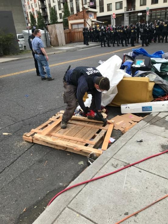 FPS Officer Disassembles Demonstration Debris
