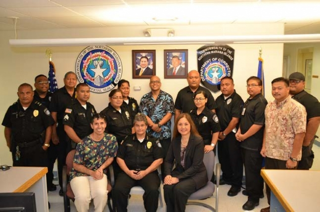 Picture of Trainer Michael G. Santos, U.S. Attorney Alicia Limtiaco, AUSA/Prevention and Reentry Coordinator Stephen Leon Guerrero, National Security Specialist/DOSM Joe Quitano, and NMI DOC Commissioner Georgia Cabrera, at training held at the NMI Department of Corrections for DOC officers in Saipan