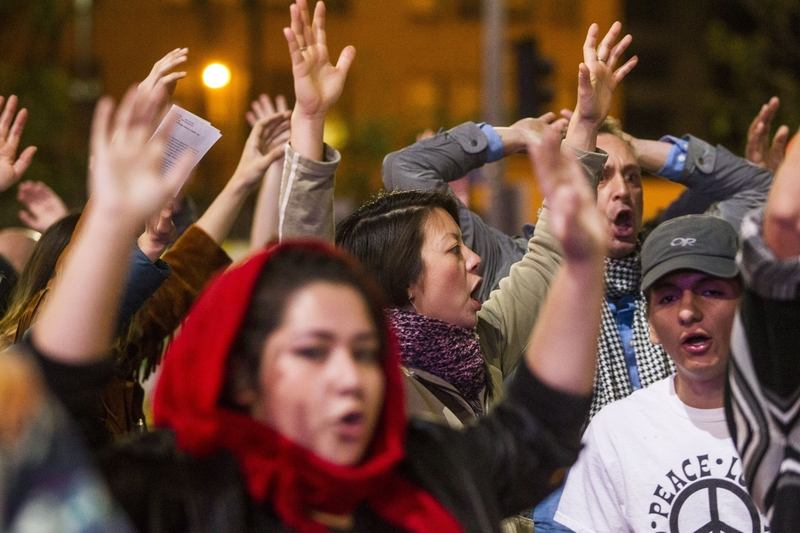 Demonstrators raise their hands during demonstrations following Michael Brown's shooting.